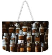 old pharmacy 2 - Old glass bottle with medicine powder of xviii century Weekender Tote Bag