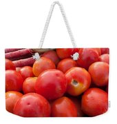 Pile Of Red Luscious Tomatoes Along With Carrots On A Vegetable Basket Weekender Tote Bag