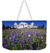 Purple Flowers Blooming Beneath Mount Weekender Tote Bag