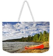 Red Canoe On Lake Shore Weekender Tote Bag