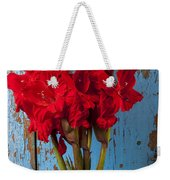 Red Glads Against Blue Wall Weekender Tote Bag