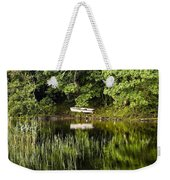 Rowboat Moored On The Bank Of A Lake Weekender Tote Bag