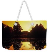 Silhouetted Home And Trees Near Water Weekender Tote Bag