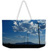 Silhouetted Telephone Poles Under Puffy Weekender Tote Bag