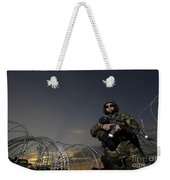 Soldier Patrols The Perimeter Of Camp Weekender Tote Bag