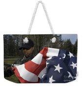 Soldier Unfurls A New Flag For Posting Weekender Tote Bag by Stocktrek Images