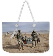 Soldiers Carry An Rq-11 Raven Unmanned Weekender Tote Bag