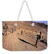 Soldiers Patrol To A Village Weekender Tote Bag