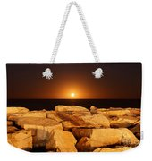The Moon Rising Behind Rocks Lit Weekender Tote Bag