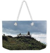 The Structure Of An Abandoned Temple On The Top Of A Green Covered Hill With Blue And White Clouds I Weekender Tote Bag