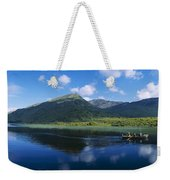 Three People On A Boat In The Lake Weekender Tote Bag