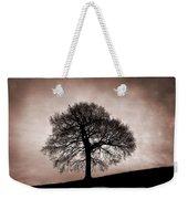 Tree Against A Stormy Sky Weekender Tote Bag