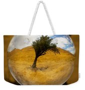 Tree In A Field Through A Glass Eye Weekender Tote Bag