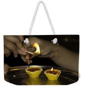 Trying To Light An Oil Lamp That Has Gone Out Weekender Tote Bag
