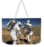 Two Astronauts Collect Soil Samples Weekender Tote Bag by Stocktrek Images
