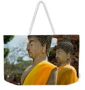 Two Buddha Statues Wrapped In An Orange Scarf  Weekender Tote Bag