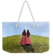 Two Girls In Vintage Dresses Walking Up Grassy Hill Weekender Tote Bag