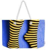 Two Legs Against Blue Wall Weekender Tote Bag