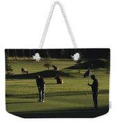 Two People Play Golf While Elk Graze Weekender Tote Bag