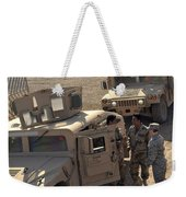 U.s. Army Soldier Speaks With Iraqi Weekender Tote Bag by Stocktrek Images