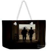 U.s. Army Soldiers Patrol A Village Weekender Tote Bag