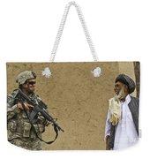 U.s. Army Specialist Talks To An Afghan Weekender Tote Bag by Stocktrek Images