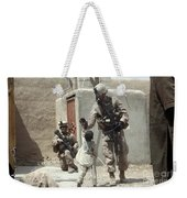 U.s. Marine Gives An Afghan Child Weekender Tote Bag