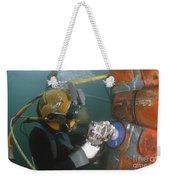 U.s. Navy Diver Uses A Grinder To File Weekender Tote Bag by Stocktrek Images