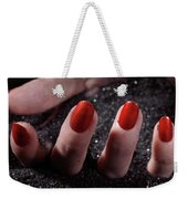 Woman Hand With Red Nail Polish Buried In Black Sand Weekender Tote Bag