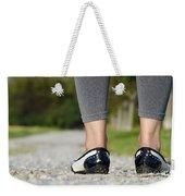 Woman Standing On A Stone Road Weekender Tote Bag