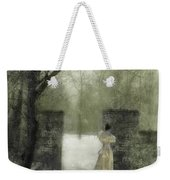 Young Lady By Stone Pillar In Snow Weekender Tote Bag