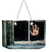 Young Woman Looking Through Hole In Window Weekender Tote Bag by Jill Battaglia