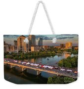 A Beautiful Sunset Falls On The Austin Skyline As Thousands Of Bat Watchers Line The Congress Avenue Bridge During The Annual Bat Fest To Watch The Bats Take Flight Weekender Tote Bag