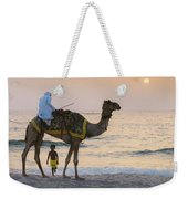 Little Boy Stares In Amazement At A Camel Riding On Marina Beach In Dubai, United Arab Emirates -  Weekender Tote Bag