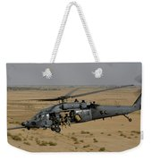 A U.s. Air Force Hh-60 Pavehawk Flies Weekender Tote Bag