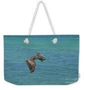 Beautiful Pelican In Flight Over The Water In Aruba Weekender Tote Bag