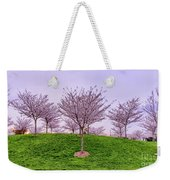 Flowering Young Cherry Trees On A Green Hill In The Park  Weekender Tote Bag