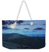 Light On Stone Mountain Slope With Forest At Night Weekender Tote Bag