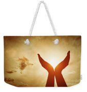 Raised Hands Catching Sun On Sunset Sky. Concept Of Spirituality, Wellbeing, Positive Energy Weekender Tote Bag