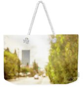 The Hedge By The Sidewalk During Day In The City Of Los Angeles Weekender Tote Bag