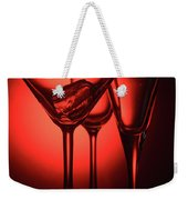 Three Empty Cocktail Glasses On Red Background Weekender Tote Bag