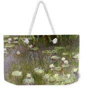 Waterlilies At Midday Weekender Tote Bag by Claude Monet