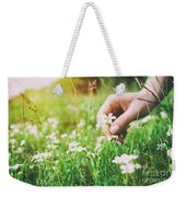 Woman Picking Up Flowers On A Meadow, Hand Close-up. Vintage Light Weekender Tote Bag