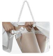 Woman Putting On White Stockings Weekender Tote Bag