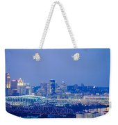 Buildings In A City Lit Up At Dusk Weekender Tote Bag