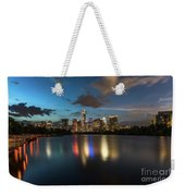 Clouds Roll Over The Austin Skyline As The Neon Reflects In The Glass-like Waters Of Lady Bird Lake Weekender Tote Bag