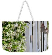 Colonial Home Exterior With Vertical Plants And Old Lanterns Displayed On The Side Of Home Weekender Tote Bag