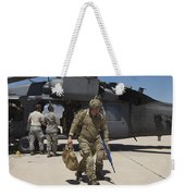 Pararescuemen Walks Away From A Hh-60g Weekender Tote Bag