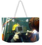 U.s. Navy Diver Welds A Repair Patch Weekender Tote Bag by Stocktrek Images