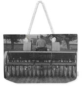 A Farmer Driving A Tractor Weekender Tote Bag